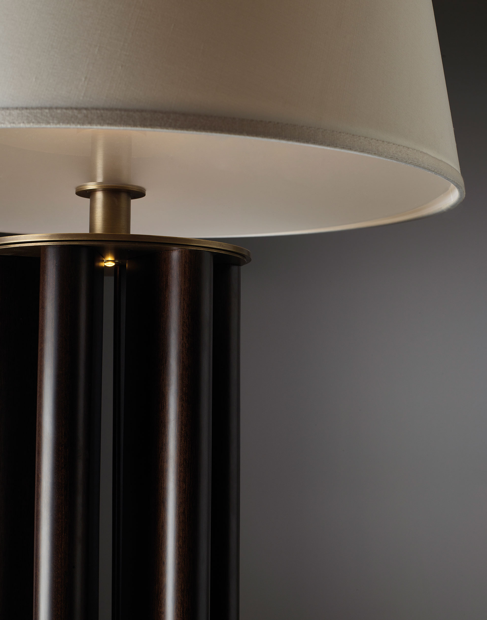 Detail of Clori, a floor LED lamp with leather or wooden structure, bronze base and details and linen, cotton or silk with handmade edge, from Promemoria's Amaranthine Tales collection | Promemoria