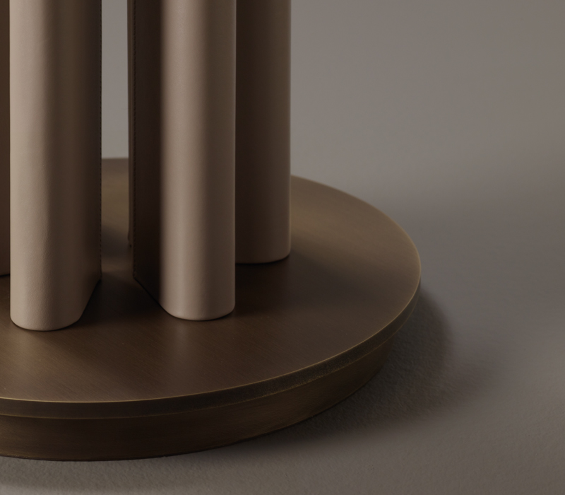Bronze base detail of Clori, a floor LED lamp with leather or wooden structure, bronze details and linen, cotton or silk with handmade edge, from Promemoria's Amaranthine Tales collection | Promemoria