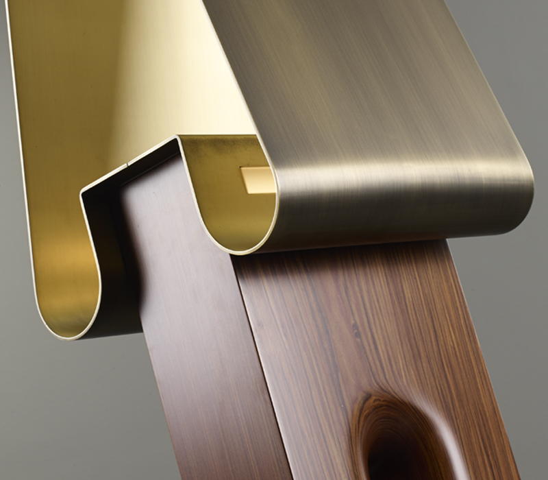 Detail of Dodoma, a floor lamp with wooden structure, an external bronze shade and an internal brass and Murano glass shade, from Promemoria's Capsule Collection by Bruno Moinard | Promemoria