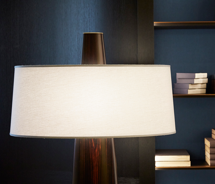 Detail of Fosca, a floor wooden LED lamp with a bronze base and a cotton, linen or hand-embroidered silk lampshade, from Promemoria's catalogue | Promemoria