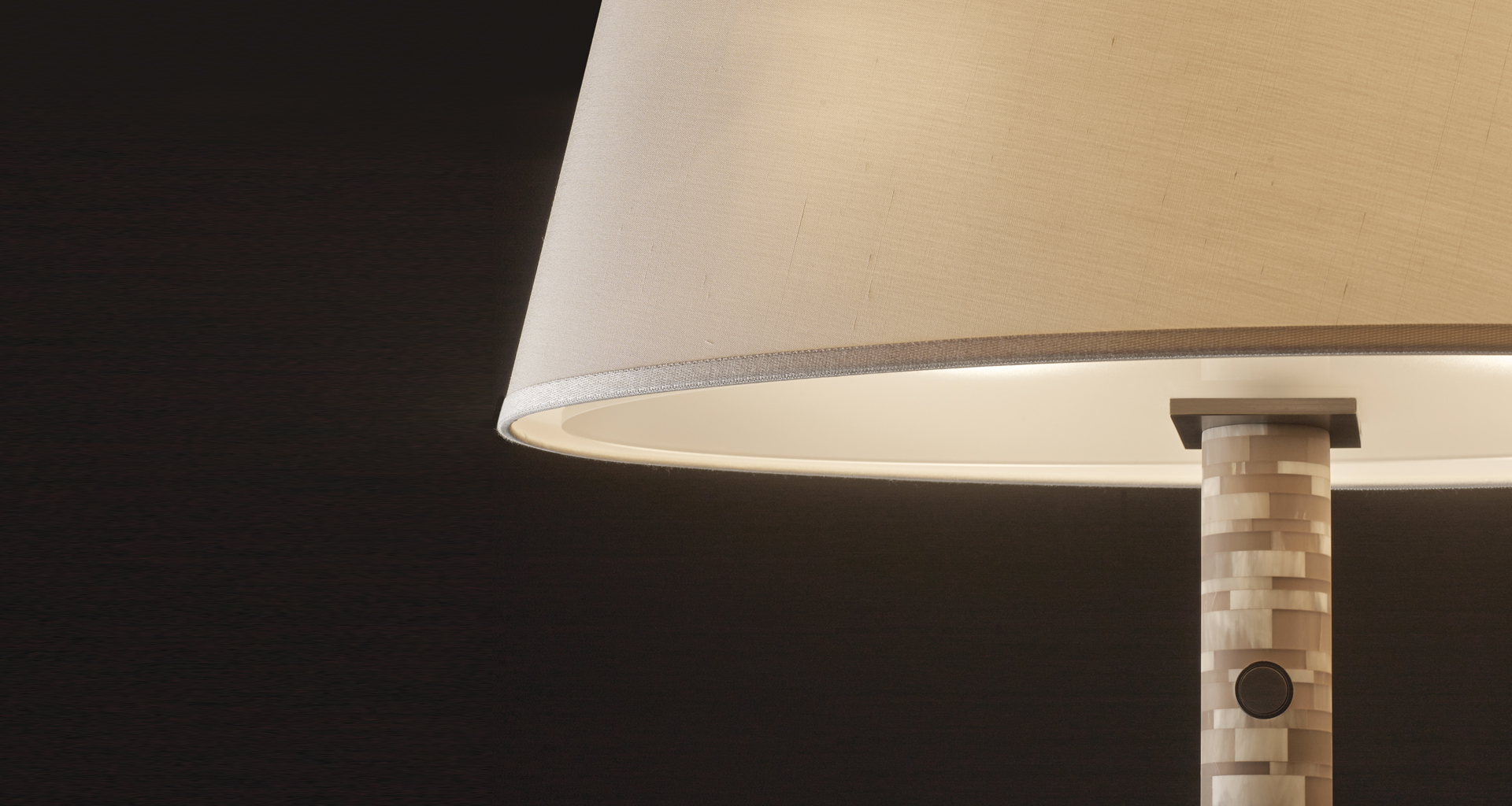 Detail of Zebù, a reading LED lamp in horn with touch ignition, bronze details and linen, cotton or silk with handmade edges lampshade, from Promemoria's catalogue | Promemoria