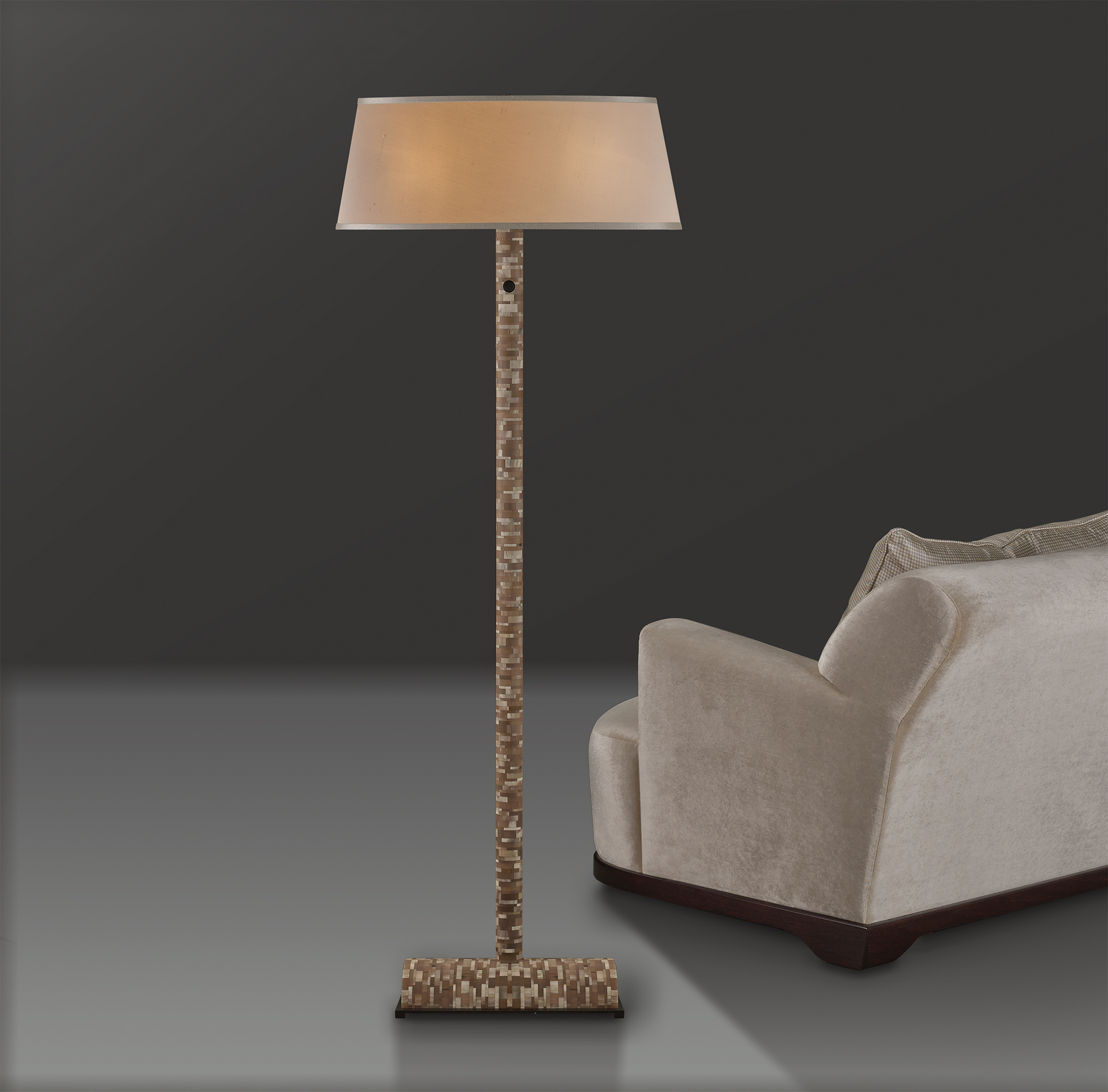 Zebù is a reading LED lamp in horn with touch ignition, bronze details and linen, cotton or silk with handmade edges lampshade, from Promemoria's catalogue | Promemoria