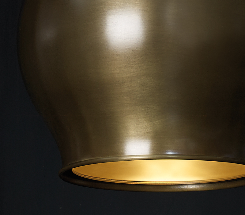 Detail of Anfora, a hanging bronze LED lamp with a methacrylate diffuser, from Promemoria's catalogue | Promemoria