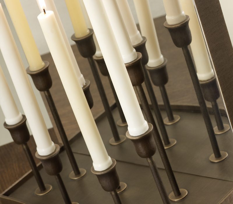Detail of Candelabro, a wall LED lamp in bronze and chrome with mirror and candles, from Promemoria's catalogue | Promemoria