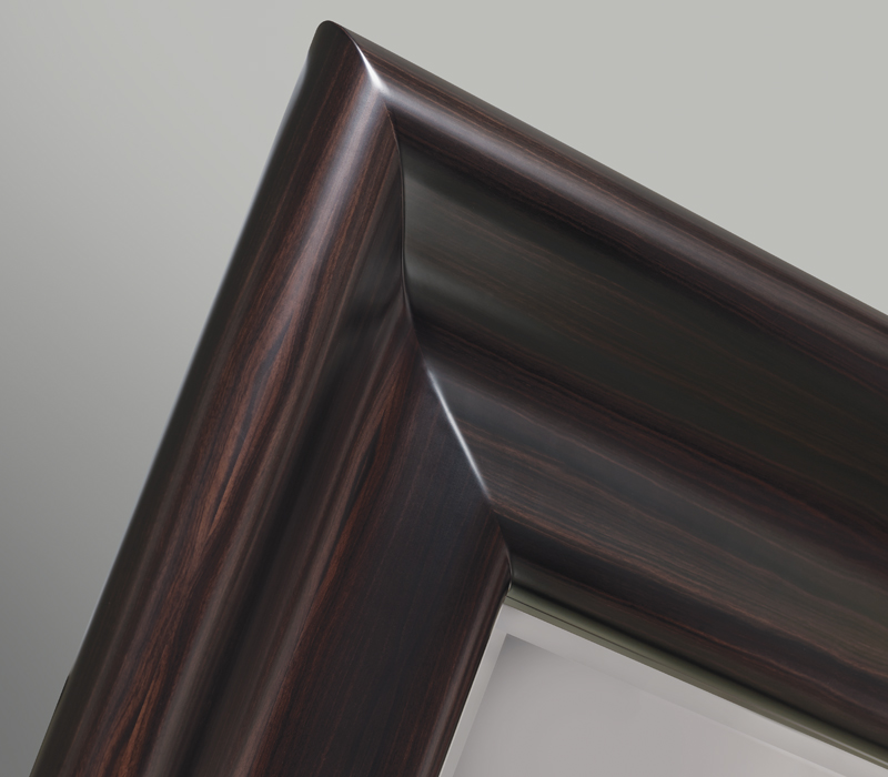 Detail of Michele, a large mirror with a wooden frame from the Promemoria's catalogue | Promemoria
