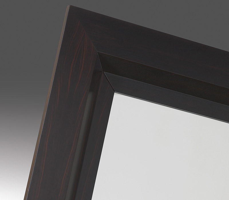 Detail of Mondù, a wall mirror with a wooden structure and a bronze base from the Promemoria's catalogue | Promemoria