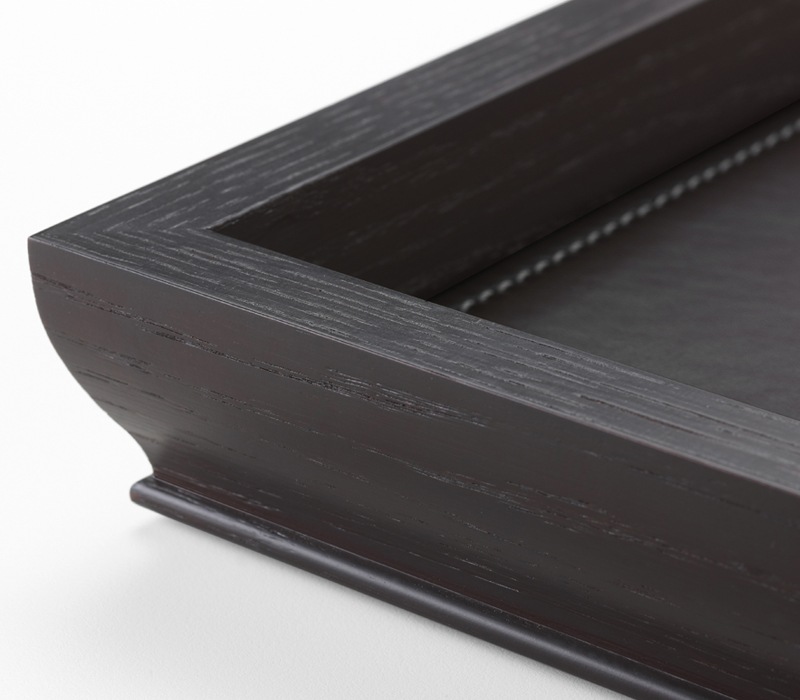 Detail of Ambrogio, a wooden tray with a leather placemat from Promemoria's catalogue | Promemoria