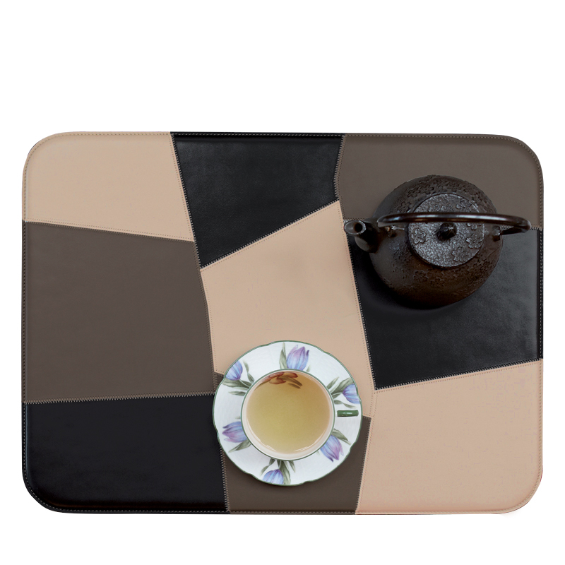 Tovaglietta Americana Patchwork is a patchwork American placemat that combines different colors of leather, from Promemoria's catalogue | Promemoria