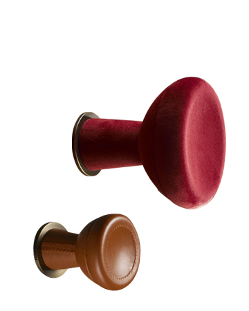 Bottone is a fabric, leather or wooden wall hanger shaped like a button, from Promemoria's catalogue | Promemoria