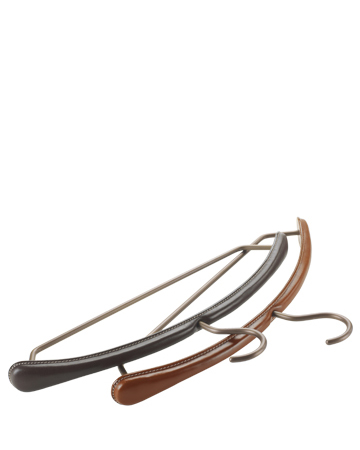 Gruccia is a leather and bronze wardrobe hanger, from Promemoria's catalogue | Promemoria