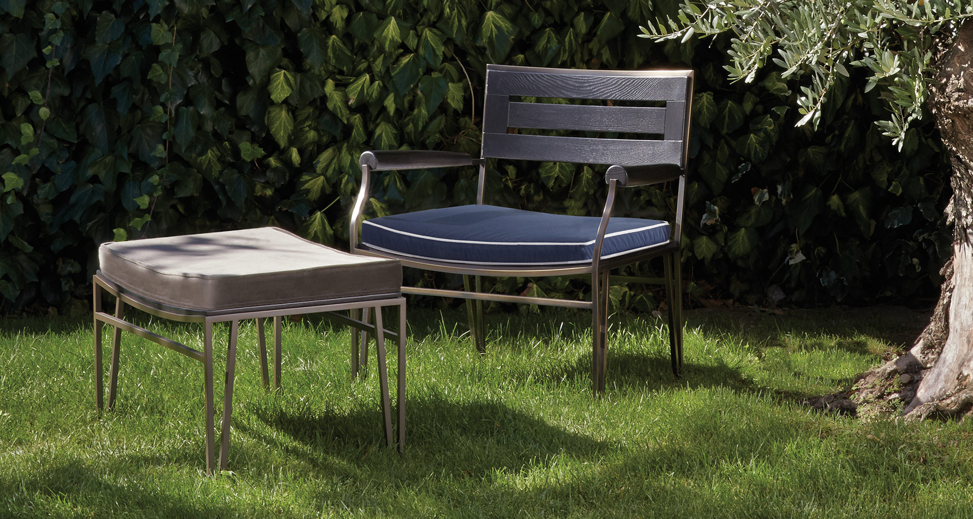 Cernobbio is a wooden and bronze armchair and pouf with fabric or leather cushion, from Promemoria's outdoor catalogue | Promemoria