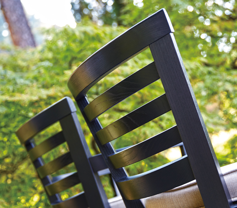 Detail of Varenna, an outdoor wooden chair with or withour armrests and fabric or leather cushion, from Promemoria's outdoor catalogue | Promemoria