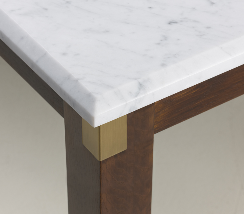 Marble top detail of Dervio, an outdoor wooden dining table with bronze feet and details, from Promemoria's outdoor catalogue | Promemoria