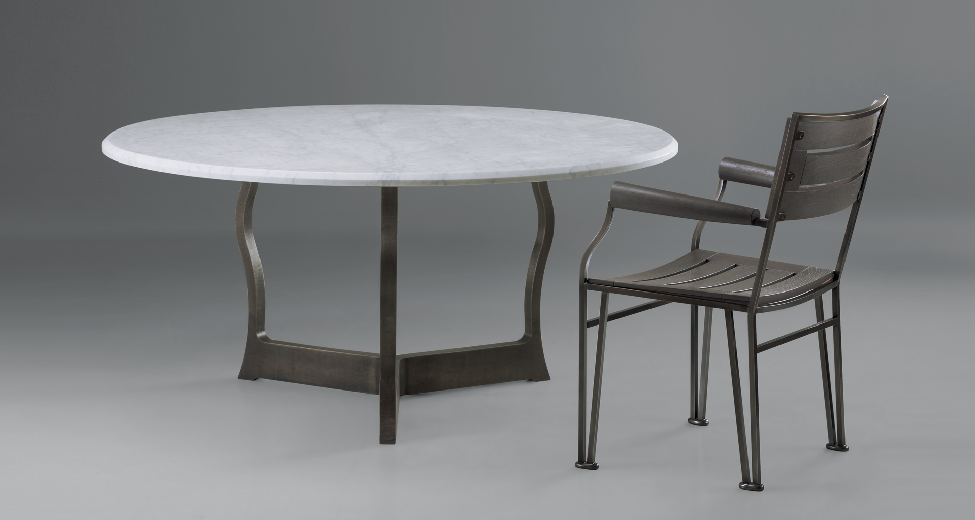 Erasmo is an outdoor dining table with bronze base and marble top, from Promemoria's outdoor catalogue | Promemoria