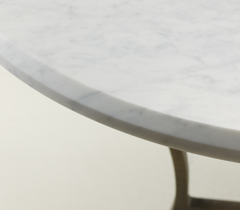 Marble top detail of Erasmo, an outdoor dining table with bronze base, from Promemoria's outdoor catalogue | Promemoria