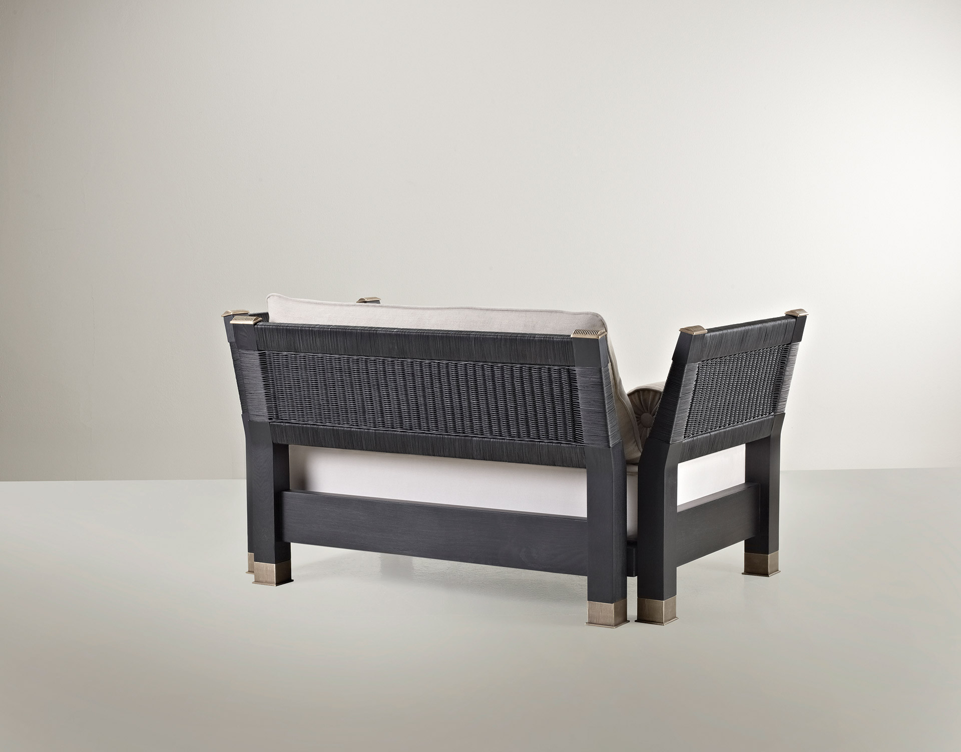 Moltrasio is an outdoor wooden sofa with bronze feet and details, from Promemoria's outdoor catalogue | Promemoria