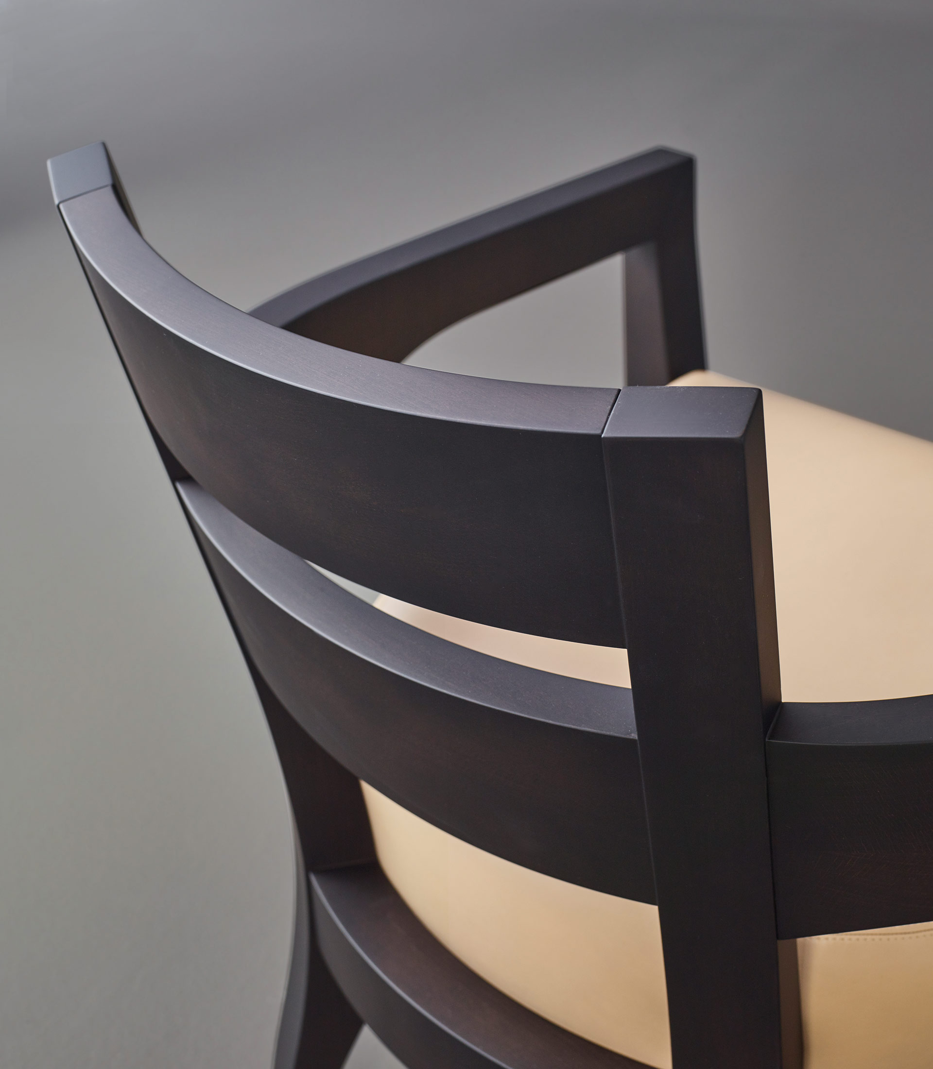 Backrest detail of Africa, a wooden armchair covered in fabric or leather, from Promemoria's catalogue | Promemoria
