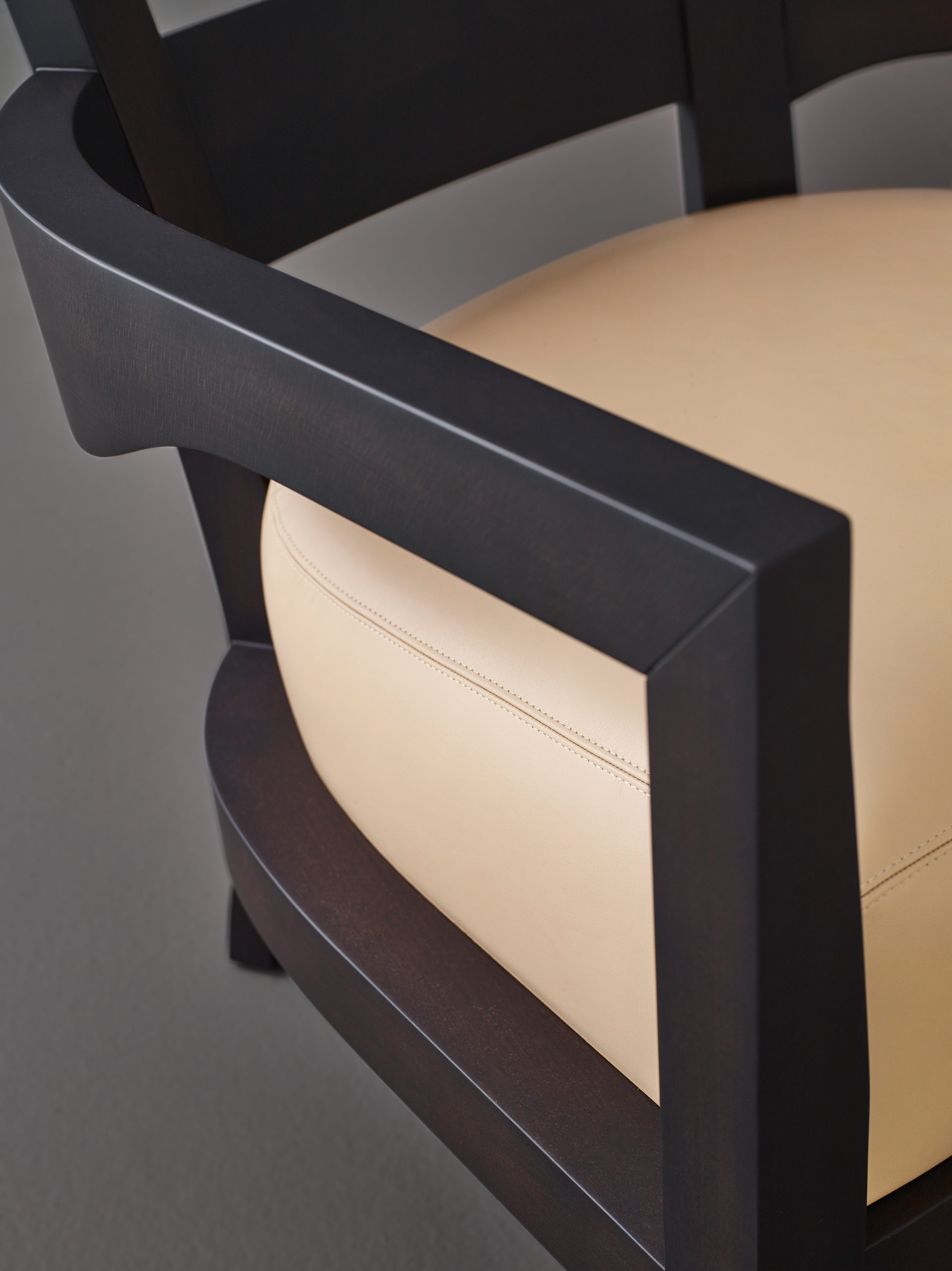 Armrest detail of Africa, a wooden armchair covered in fabric or leather, from Promemoria's catalogue | Promemoria