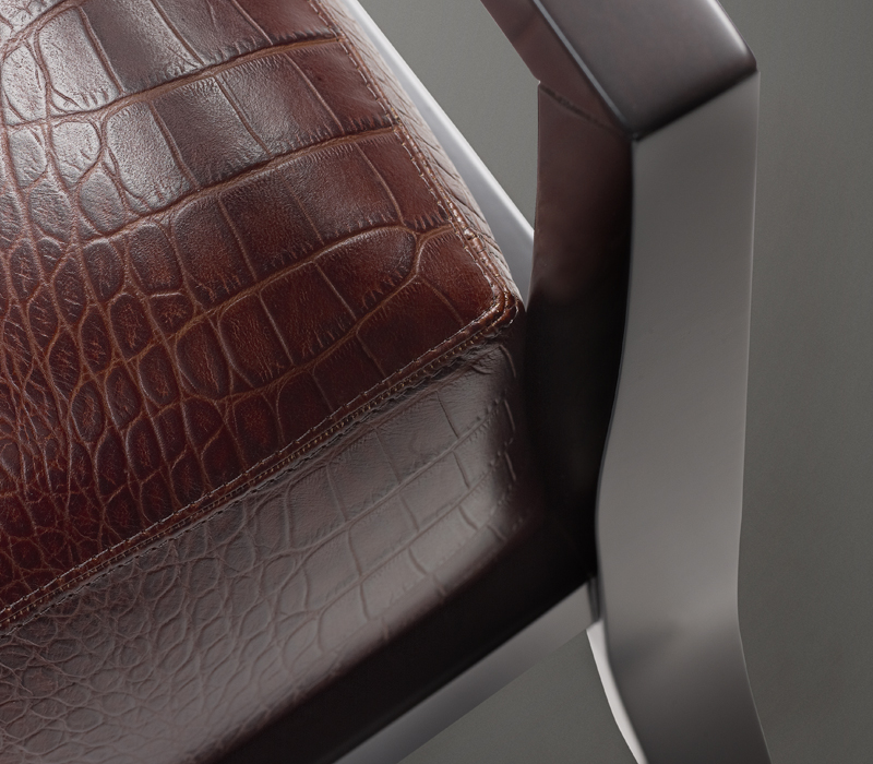 Detail of Africa, a wooden armchair covered in fabric or leather, from Promemoria's catalogue | Promemoria