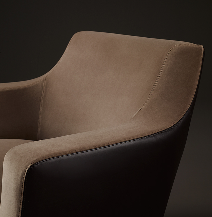 Detail of Aziza, a wooden armchair covered in fabric or leather, from Promemoria's catalogue | Promemoria