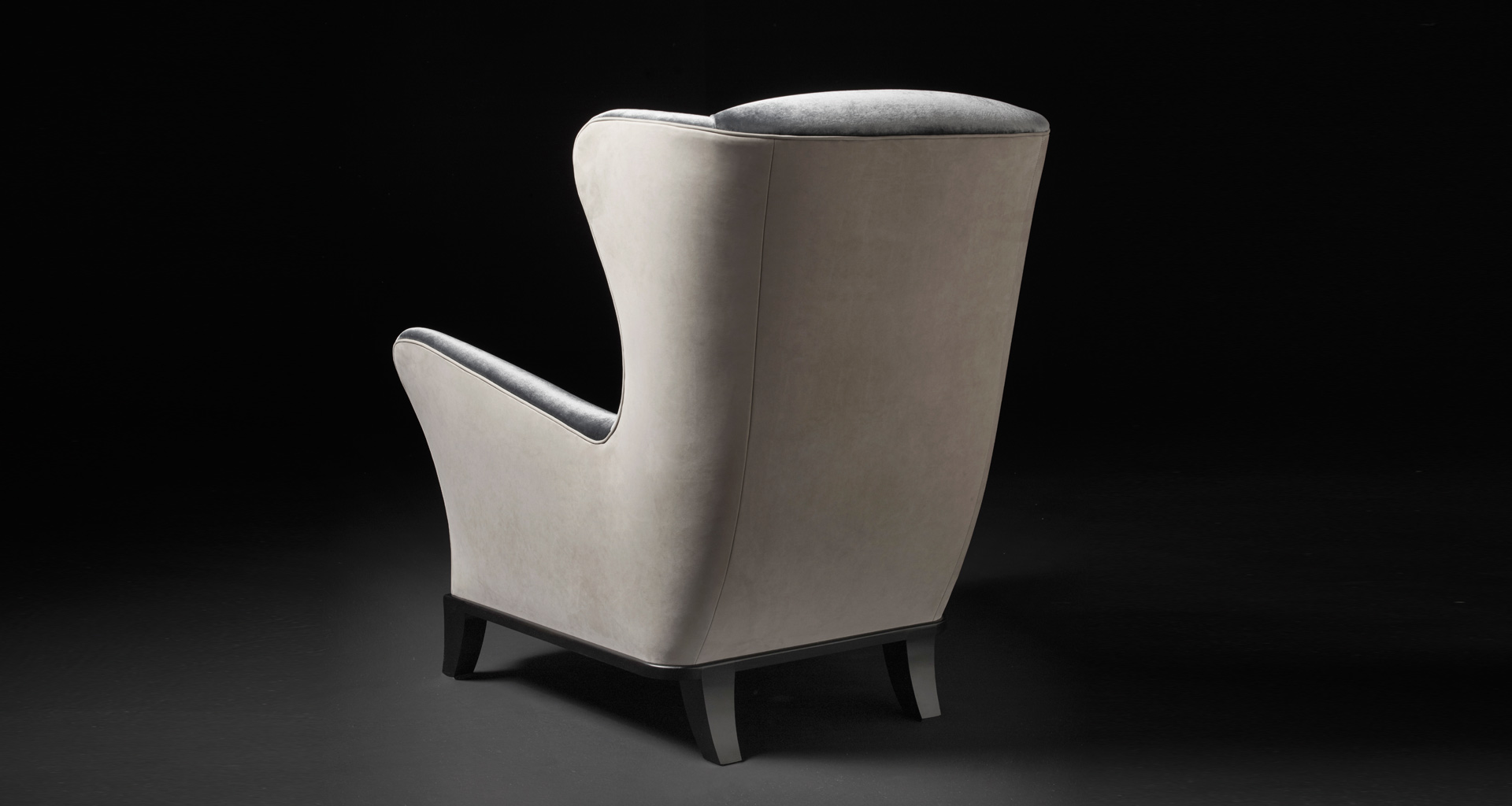 Bluette is a wooden armchair covered in fabric or leather, from Promemoria's Night Tales collection | Promemoria