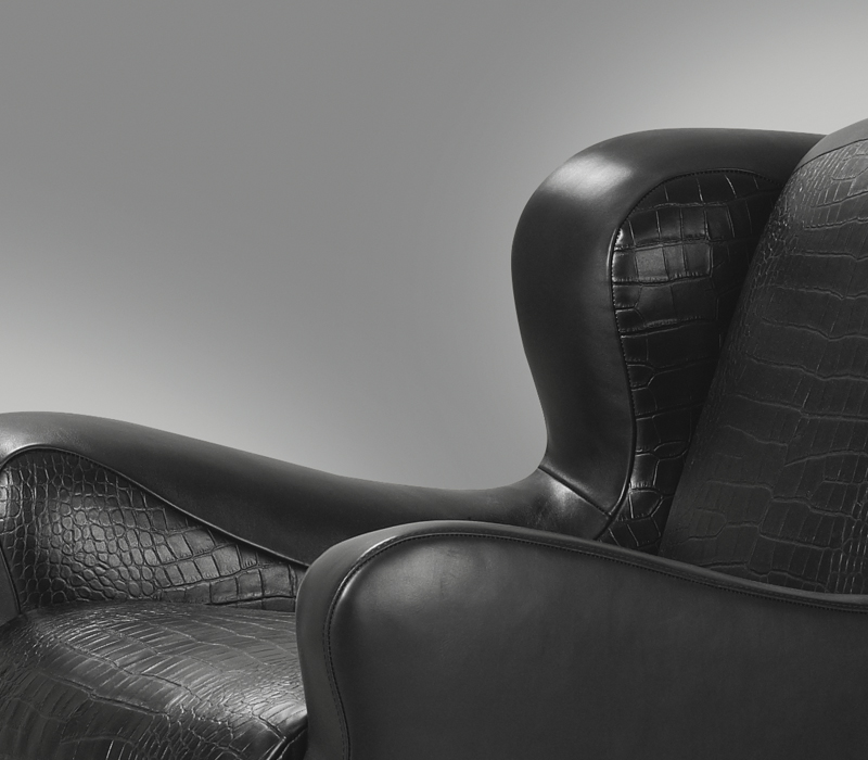 Detail of Club, an armchair with an inside covering in fabric or leather and an outer covering in leather, from Promemoria's catalogue | Promemoria