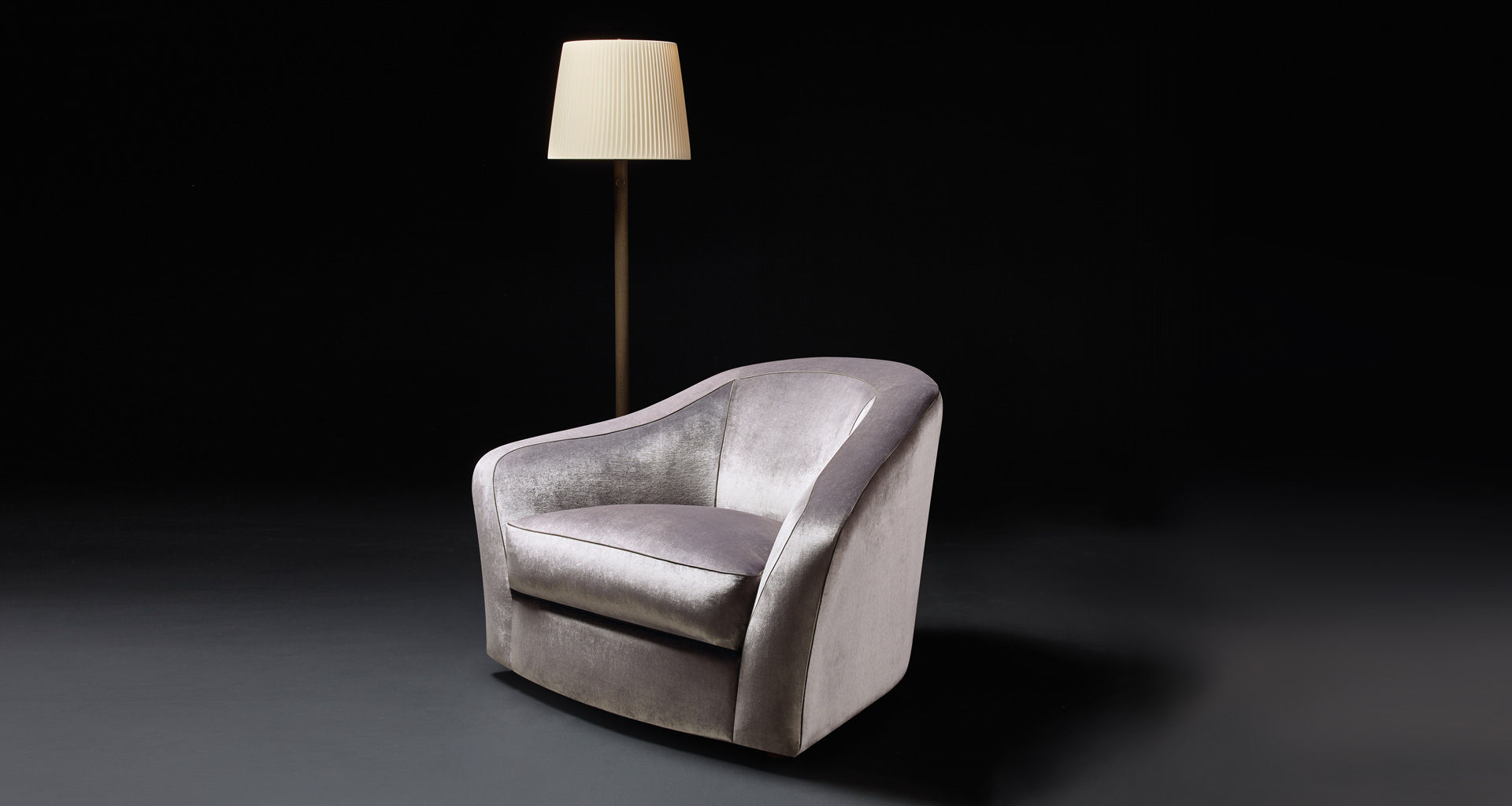 Fiore di Loto is an armchair for two covered in fabric or leather, from Promemoria's catalogue | Promemoria