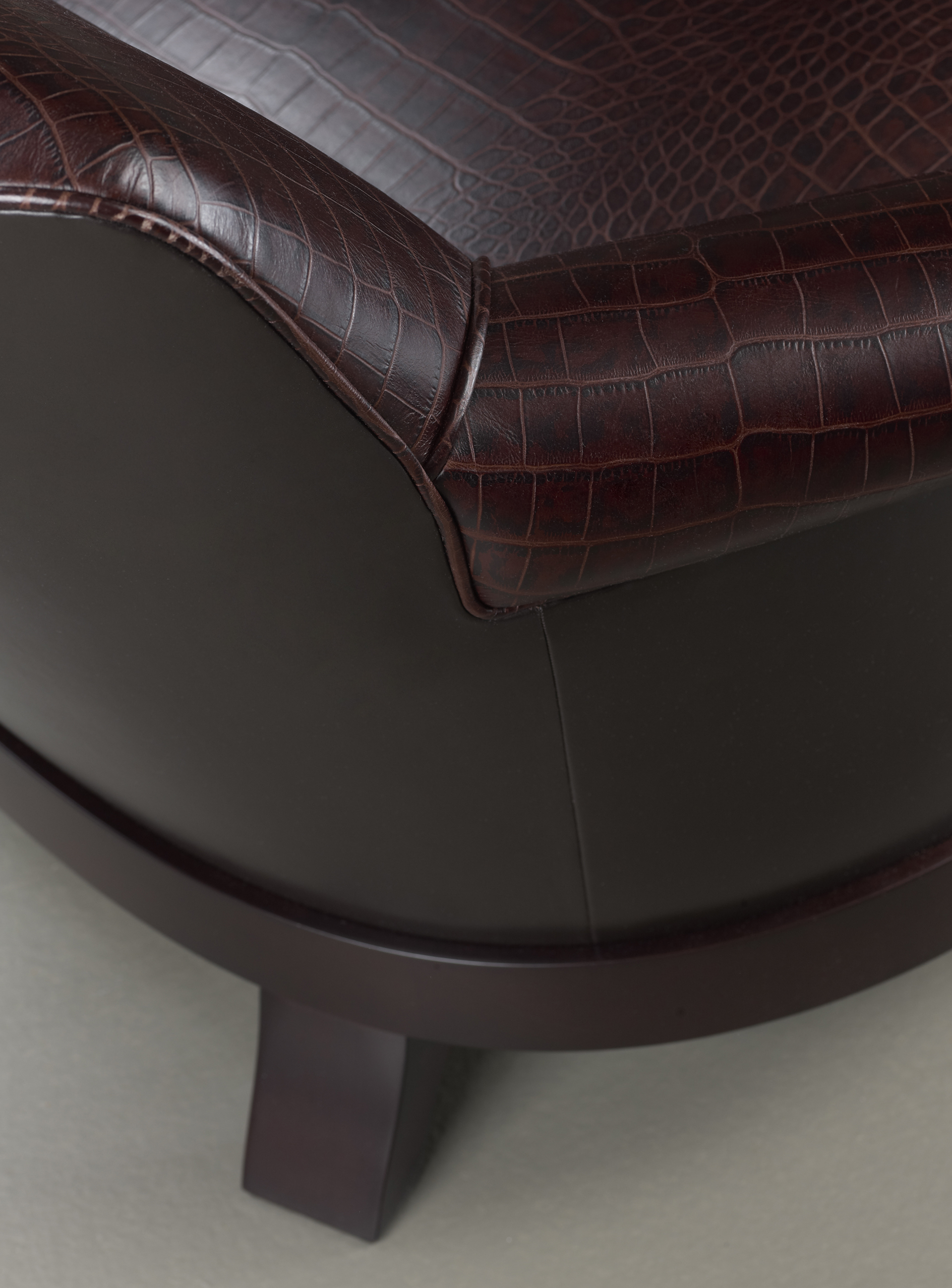 Detail of Gacy, a wooden armchair covered in fabric or leather, from Promemoria's catalogue | Promemoria
