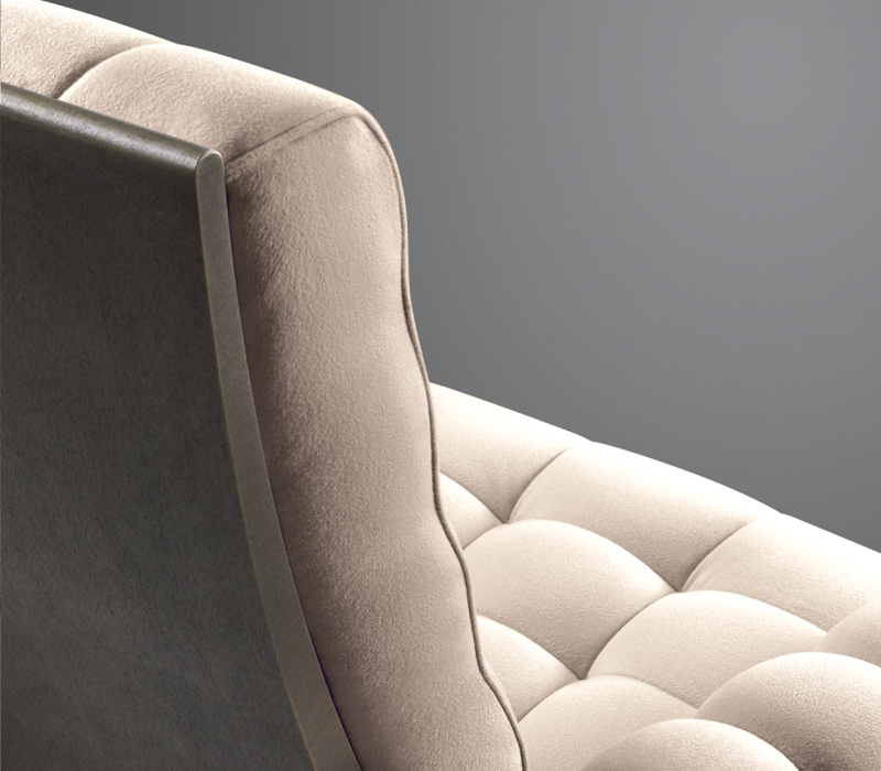 Bronze backrest detail of Gertrude, a reclining armchair with capitonné covering, from Promemoria's Lake Tales collection | Promemoria