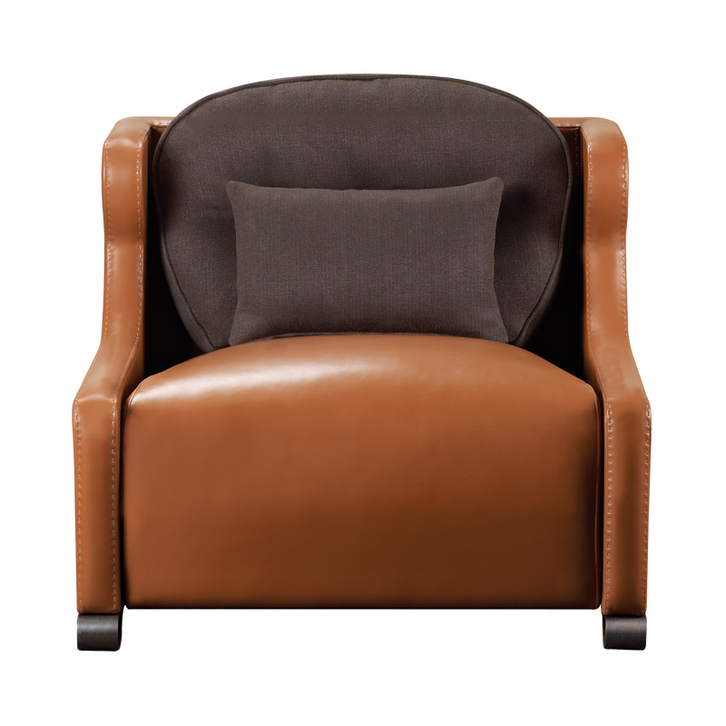 Gilda is a wooden armchair covered in fabric with bronze feet, from Promemoria's catalogue | Promemoria
