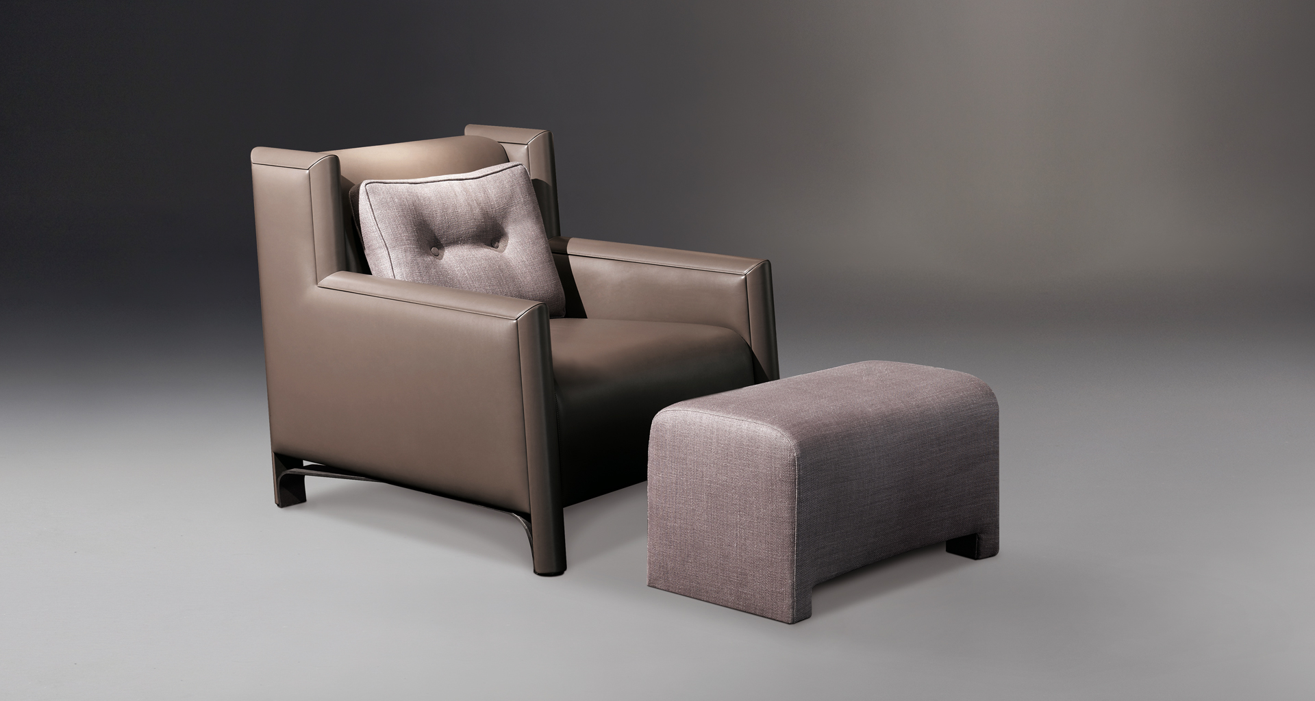 Ginevra is a wooden armchair covered in leather or fabric with bronze feet, from Promemoria's catalogue | Promemoria