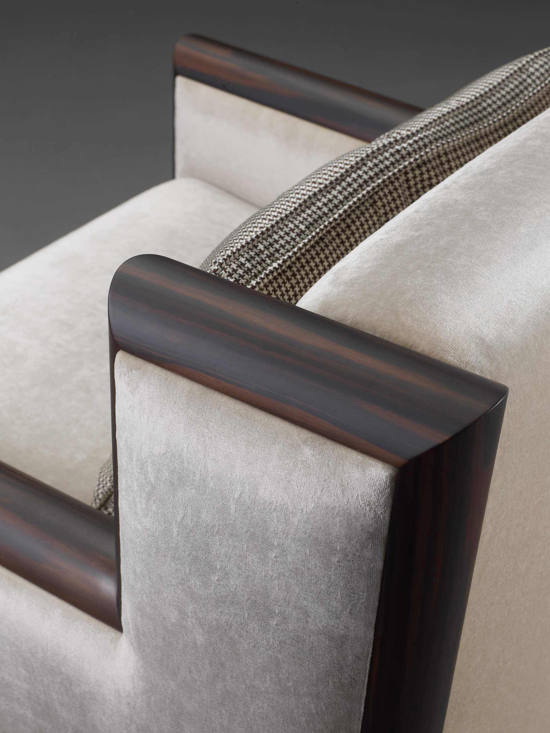Detail of Ginevra, a wooden armchair covered in leather or fabric with bronze feet, from Promemoria's catalogue | Promemoria