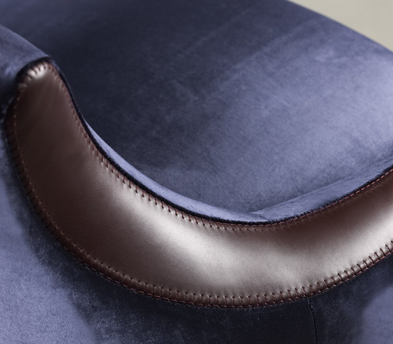 Leather detail of Gioconda and Giocondina, two fabric armchairs from Promemoria's catalogue | Promemoria