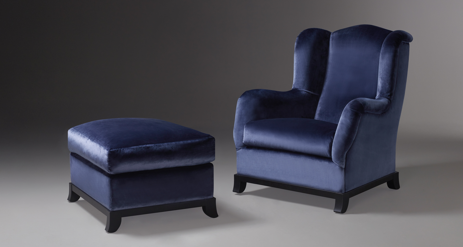 Madame A is an armchair covered in fabric or leather with wooden base, from Promemoria's catalogue | Promemoria
