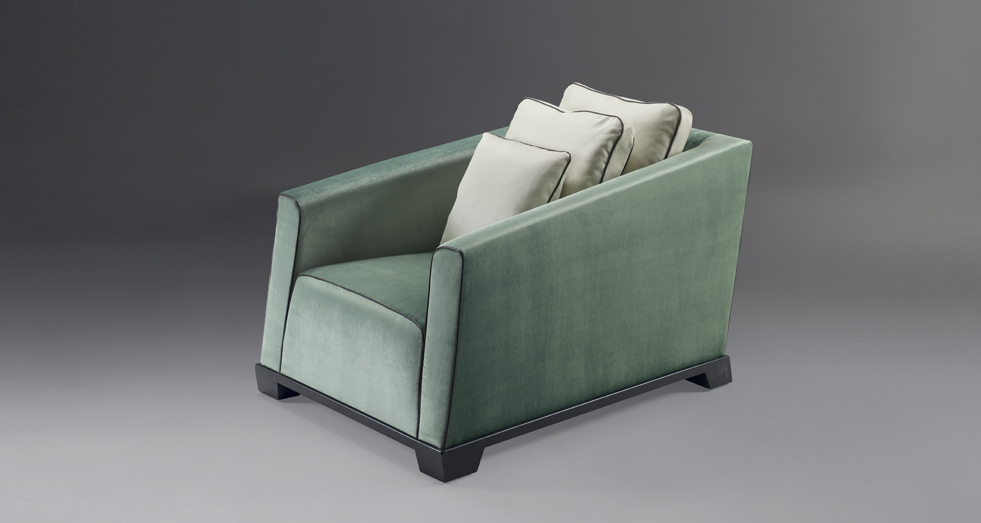 Martini is an armchair covered in fabric or leather with bronze feet, from Promemoria's catalogue | Promemoria