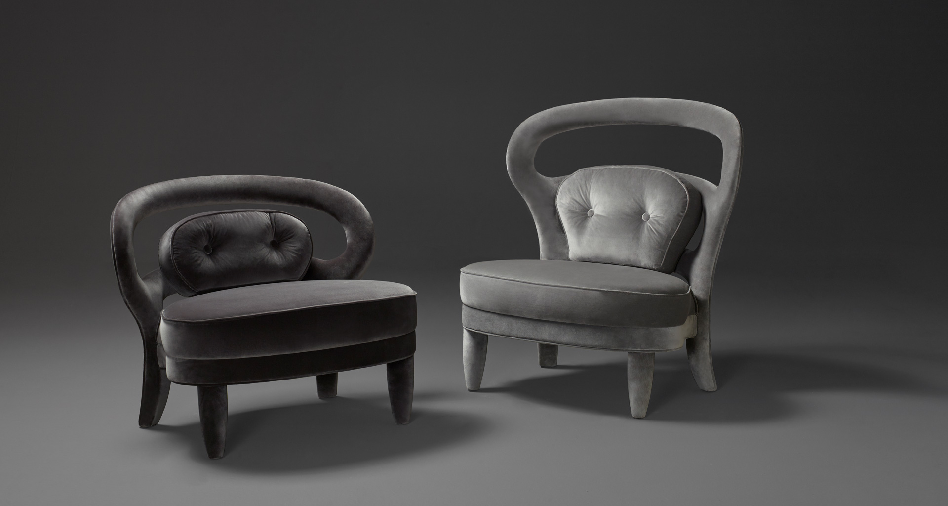Nina is an armchair covered in fabric or leather with high or low back, from Promemoria's catalogue | Promemoria