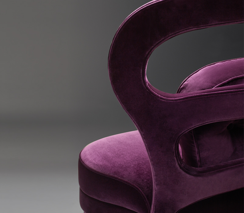 Backrest detail of Nina, an armchair covered in fabric or leather with high or low back, from Promemoria's catalogue | Promemoria