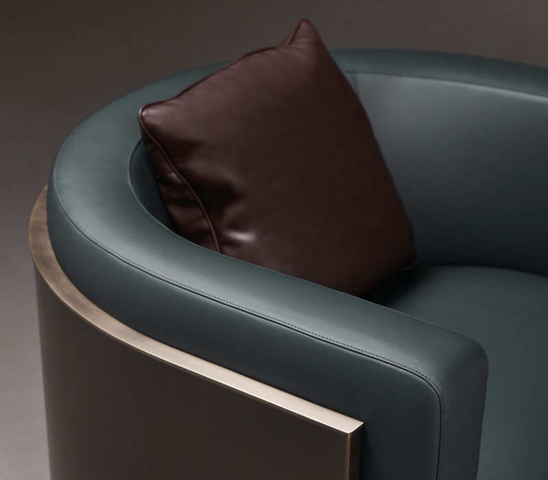 Pervinca is a swivel bronze armchair with a wooden base and fabric covering, from Promemoria's Amaranthine Tales collection | Promemoria
