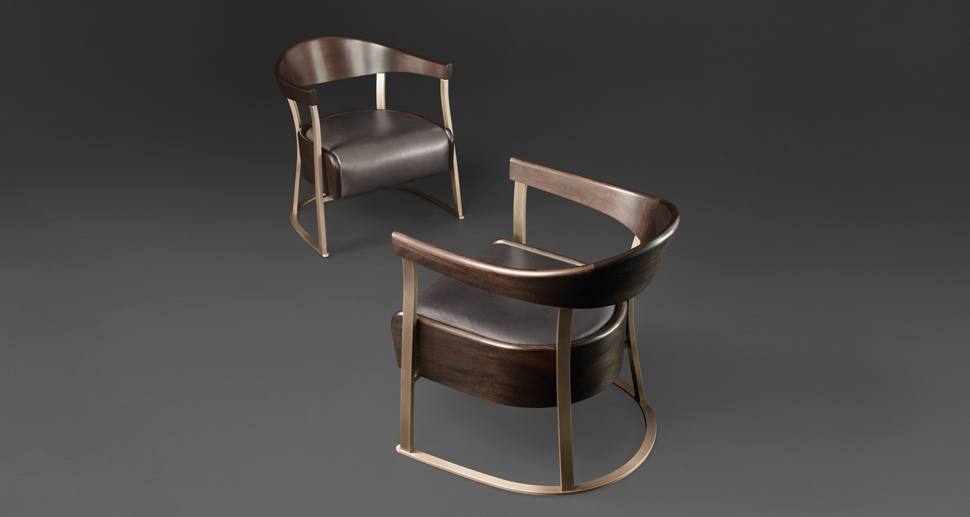Rachele is a bronze armchair covered in leather, from Promemoria's catalogue | Promemoria