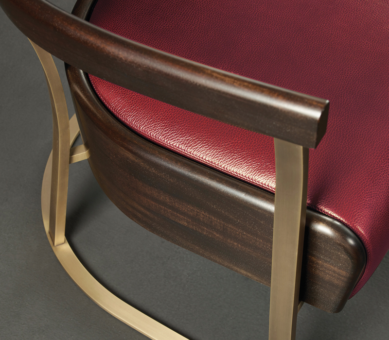 Bronze structure detail of Rachele, a bronze armchair covered in leather, from Promemoria's catalogue | Promemoria