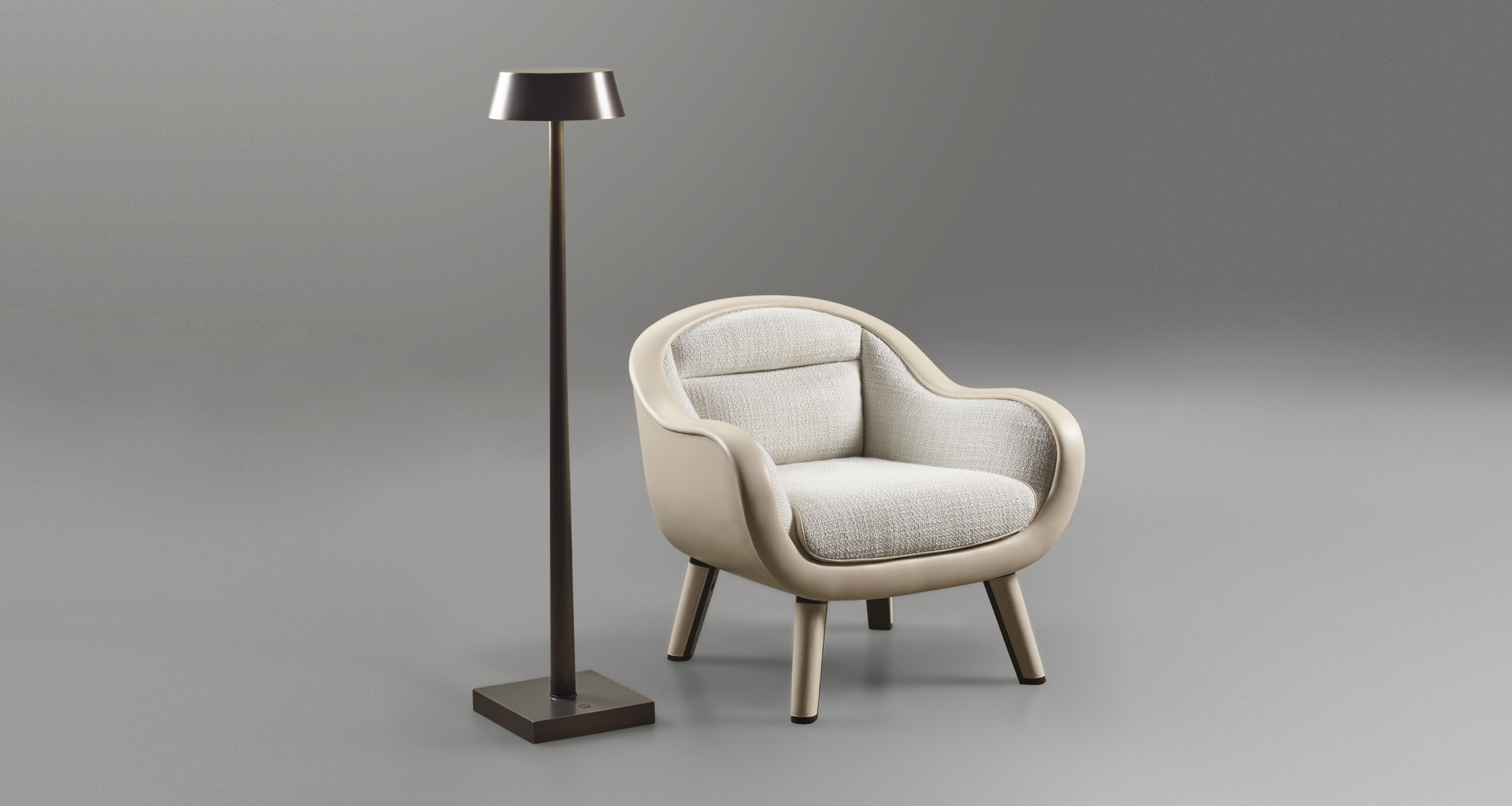Vittoria is a wooden armchair with fabric or leather seat and a bronze handle on the back, from Promemoria's catalogue | Promemoria