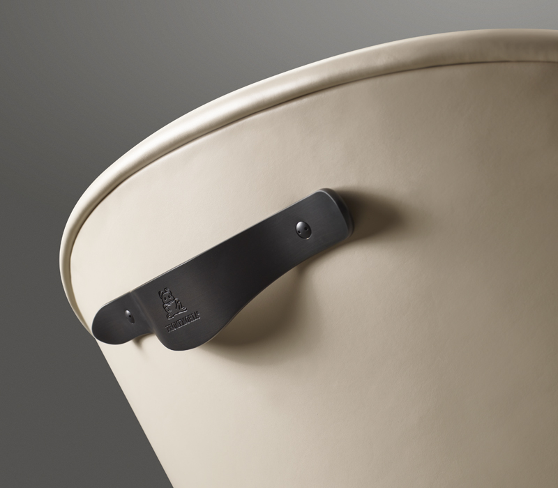 Bronze back handle detail of Vittoria, a wooden armchair with fabric or leather seat, from Promemoria's catalogue | Promemoria