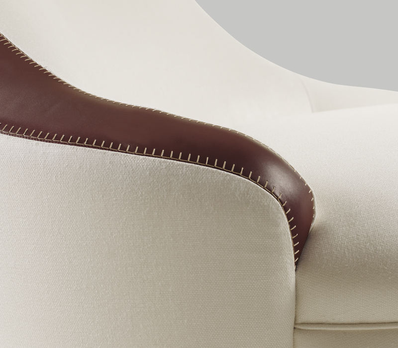 Leather detail of Gioconda, a chaise longue convered in fabric, from Promemoria's catalogue | Promemoria