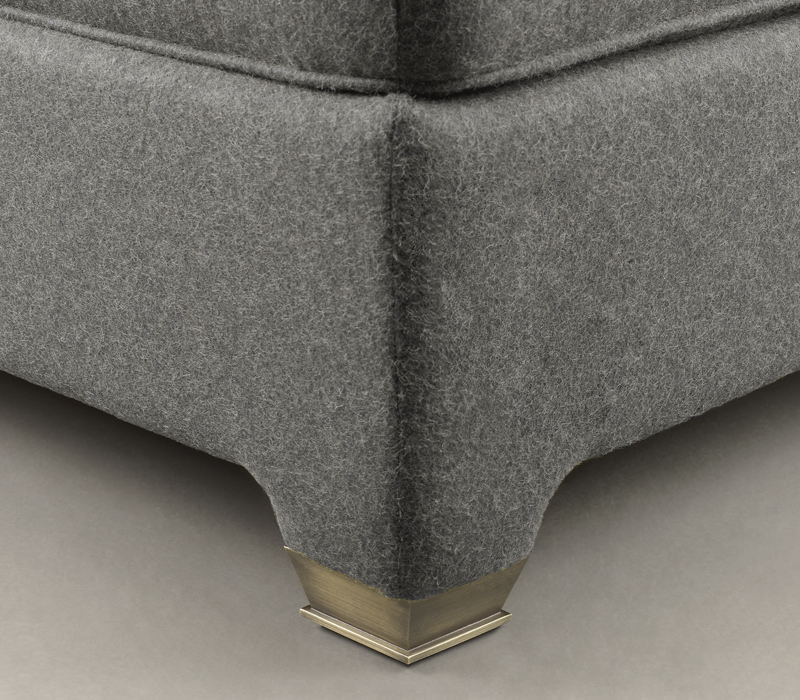 Feet details of Augusto, a pouf covered in leather or fabric, from Promemoria's catalogue | Promemoria