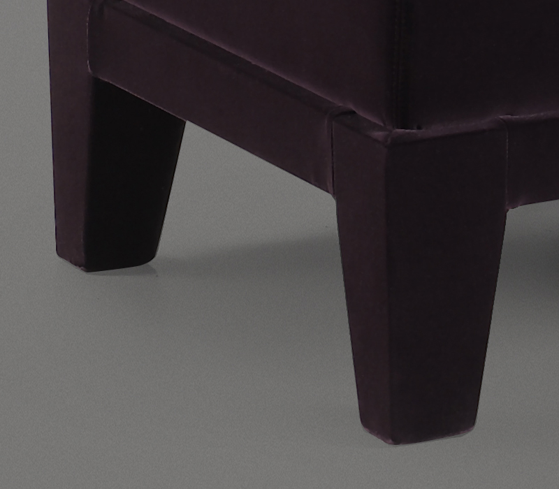 Wooden base detail of Aziza, a wooden pouf with a cushion covered in fabric or leather, from Promemoria's catalogue | Promemoria