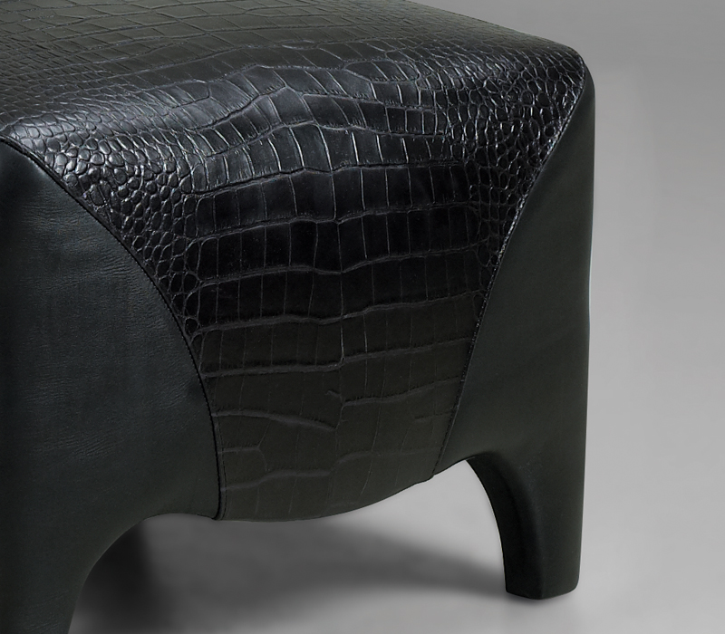 Detail of Club, a pouf covered in fabric and leather, from Promemoria's catalogue | Promemoria