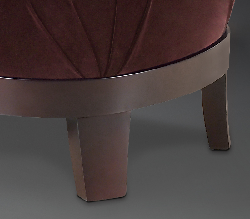 Wooden base detail of Gacy, a wooden pouf covered in fabric or leather, from Promemoria's catalogue | Promemoria