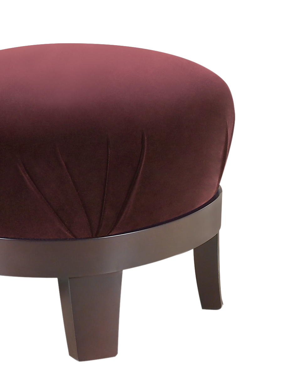 Gacy is a wooden pouf covered in fabric or leather, from Promemoria's catalogue | Promemoria