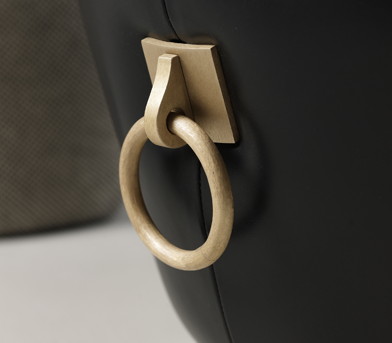 Bronze handle detail of Gioconda, a pouf covered in fabric or leather, from Promemoria's catalogue | Promemoria
