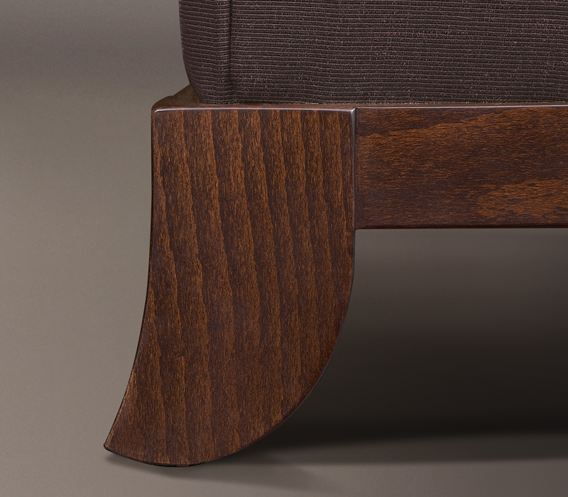 Wooden feet detail of Madame A, a wooden pouf covered in fabric or leather, from Promemoria's catalogue | Promemoria